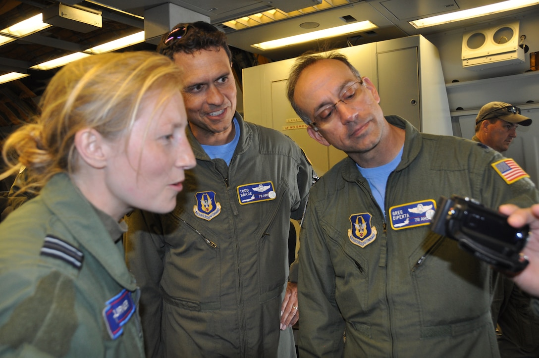Royal Air Force Flt. Lt. Tori Turner, left, views the video taken of her piloting the Eurofighter Typhoon while performing an infrequent refueling training mission with the KC-10 Extender tanker June 6. Reserve tanker pilots, Lt. Cols. Todd Brace and Greg Dipenta, middle and right, of the 78th Air Refueling Squadron from Joint Base McGuire-Dix-Lakehurst, N.J., were part of the crew that refueled seven Typhoons during the D-Day training flight, which took place along a refueling track near Royal Air Force Leuchars, United Kingdom. (U.S. Air Force photo/Master Sgt. Donna T. Jeffries)