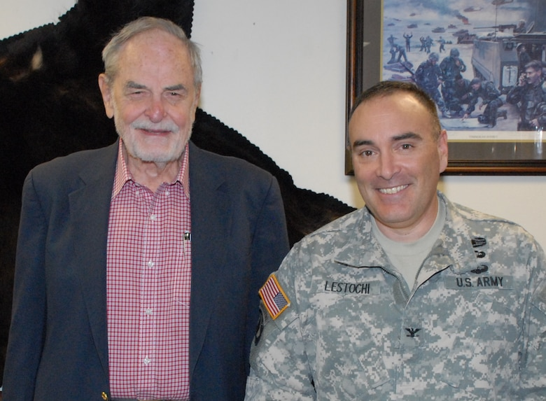 Retired Col. Amos Mathews is one of 26 soldiers to have served as the Alaska District commander during the 68-year history of the organization. His image is displayed among a group of leaders that are now pillars of Corps engineering history in Alaska. An ecstatic Col. Christopher Lestochi, the current district commander, hosted Mathews during a visit to the headquarters building at Joint Base Elmendorf-Richardson June 9.