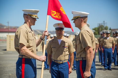 U.S. Marine Corps Maj. Jason R. Fenton, commanding officer, Prior Service Recruiting (PSR), passes off a guidon to Maj. Brad Burnett, oncoming commanding officer, PSR, aboard Camp Pendleton, Calif., June 17, 2014. The passing of the guidon symbolizes the transfer of authority from one Marine to another. (U.S. Marine Corps photo by Cpl. Catie Massey, 12th Marine Corps District/Released)