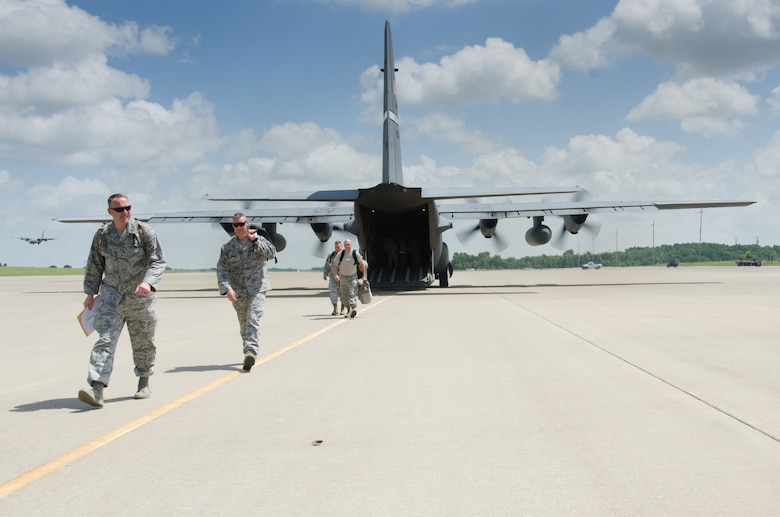 Airmen from the Kentucky Air National Guard's 123rd Contingency Response Group arrive at Fort Campbell, Ky., June 17, 2014, via a Kentucky Air Guard C-130 Hercules to participate in Capstone '14, a homeland earthquake-response exercise. The 123rd CRG is joining with the U.S. Army's 688th Rapid Port Opening Element to operate a Joint Task Force-Port Opening here from June 16 to 19, 2014. (U.S. Air National Guard photo by Master Sgt. Phil Speck)