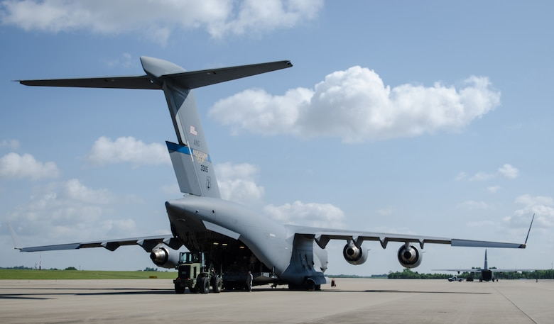 Airmen from the Kentucky Air National Guard's 123rd Contingency Response Group offload cargo from a Mississippi Air National Guard C-17 Globemaster during Capstone '14, a homeland earthquake-response exercise at Fort Campbell, Ky., on June 17, 2014. The 123rd CRG is joining with the U.S. Army's 688th Rapid Port Opening Element to operate a Joint Task Force-Port Opening here from June 16 to 19, 2014. (U.S. Air National Guard photo by Master Sgt. Phil Speck)