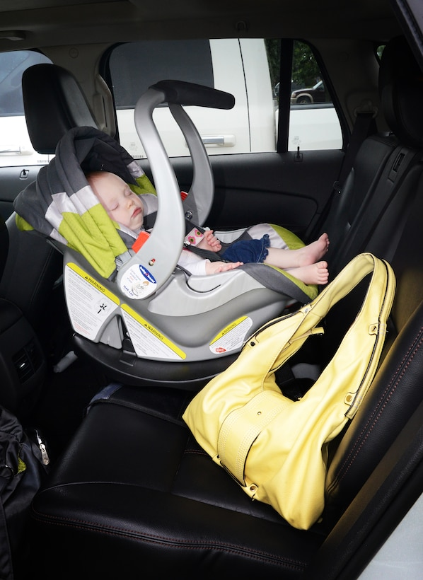 Placing a needed item such as a purse, wallet, lunch bag or uniform hat in the backseat is one way parents can avoid forgetting their child is with them. (Air Force photo illustration by Kelly White)