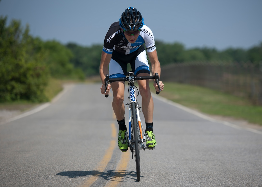 Senior Airman David Flaten, 811th Security Forces Squadron protective services member and professional cross-country mountain biker, trains at Joint Base Andrews, Md., June 18, 2014. Flaten is ranked 43rd of 250 according to USA Cycling, the official cycling organization responsible for identifying, training and selecting cyclists to represent the United States in international competition. (U.S. Air Force photo/ Senior Airman Nesha Humes)