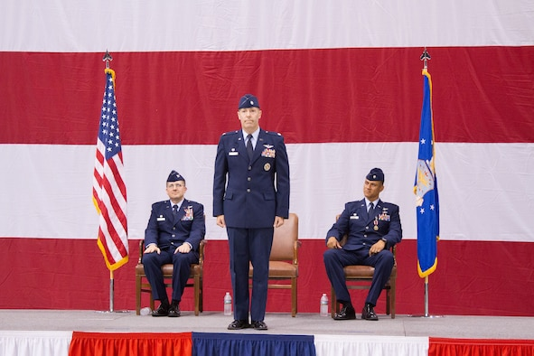 Lt. Col. Steven Tofte awaits his first salute shortly after assuming command of the 752nd Operations Support Squadron from Lt. Col. Anthony J. Owens, right. Colonel Tofte had previously served as director of operations for the 752nd OSS. Colonel Owens will be heading to Ramstein Air Base in Germany as a member of Headquarters United States Air Forces Europe. Col. Alexander Koven, 552nd Air Control Group commander, left, presided over the ceremony held June 6 in Bldg. 230, Dock 2, before a host of friends, family and fellow service members. (Air Force photo by Master Sgt. Thomas Edwards)