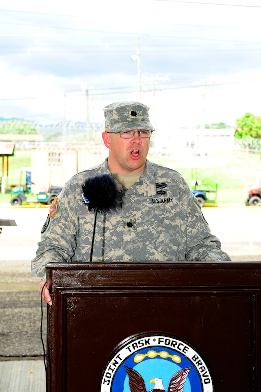 U. S. Army Lt. Col. Nicholas Dickson assumes command of the Army Forces Battalion at Soto Cano Air Base, Honduras by accepting the guidon from U. S. Army Col. Thomas Boccardi, the Joint Task Force-Bravo commander, June 16, 2014. Nicholson assumed command from outgoing commander U. S. Army Lt. Col. Alan McKewan. Army Forces Battalion is an expeditionary force ready to deploy as a resilient, integrated team capable of conducting administrative and logistical support for Joint Task Force-Bravo missions within Central America in order to counter illicit trafficking, support foreign humanitarian assistance/disaster relief and build partner nation capacity.  (Photo by Martin Chahin)