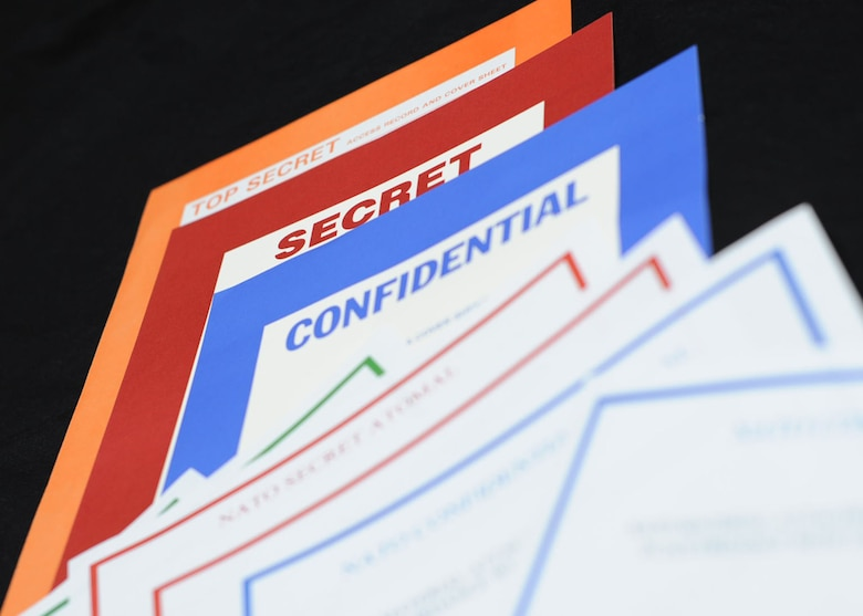 Proper labels of classified information is one of the main aspects of Information Security. (U.S. Air Force photo by Staff Sgt. Eboni Reams/Released)