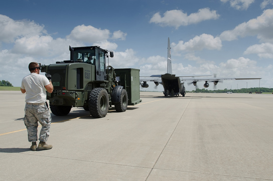 Airmen from the Kentucky Air National Guard's 123rd Contingency Response Group unload a Kentucky Air Guard C-130 Hercules during Capstone '14, a homeland earthquake-response exercise at Fort Campbell, Ky., on June 17, 2014. The 123rd CRG is joining with the U.S. Army's 688th Rapid Port Opening Element to operate a Joint Task Force-Port Opening here from June 16 to 19, 2014. (U.S. Air National Guard photo by Master Sgt. Phil Speck)