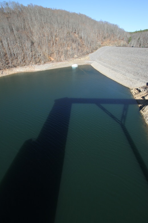 COVINGTON, Va. -- Gathright Dam's intake tower casts a shadow over Lake Moomaw. The earthen and rolled rock-fill dam, pictured in the upper right-hand corner of the photo, impounds the flow of the Jackson River and creates Lake Moomaw, serving both flood control and recreational purposes. (U.S. Army photo/Kerry Solan)