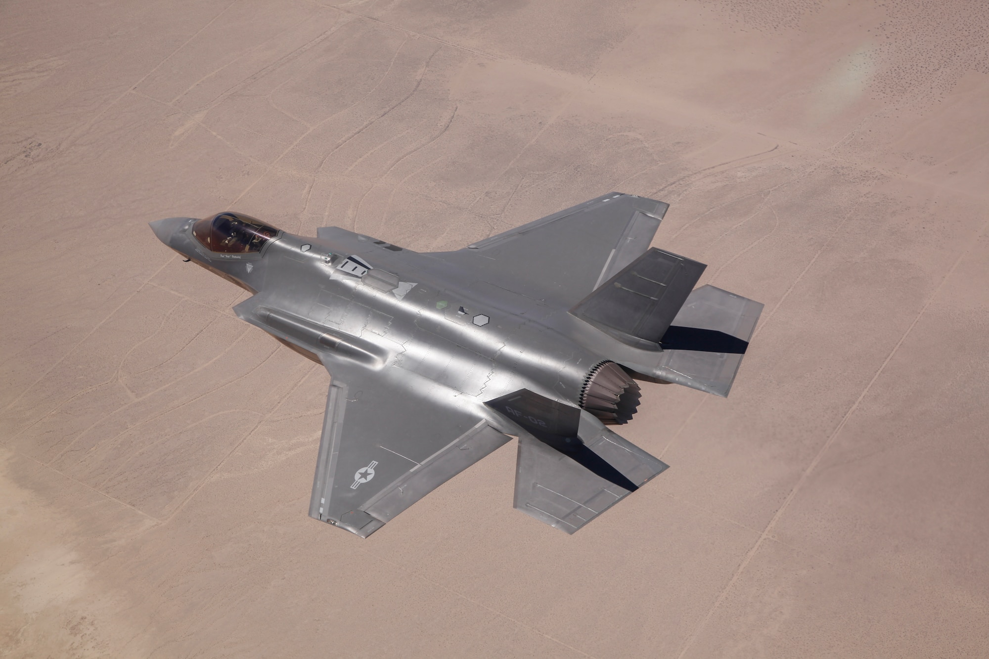 Paul Hattendorf, a Lockheed Martin test pilot, flies AF-2, the second production F-35 Lightning II for the Air Force, during an airframe loads envelope expansion mission June 11, 2014, over Edwards Air Force Base, Calif. During the test mission, AF-2 became the first F-35 to reach 1,000 flight hours. (Lockheed Martin photo/Tom Reynolds)