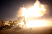 Marines with the Cannons Platoon of Tango Battery, 5th Battalion, 11th Marine Regiment, fire their M777A2 howitzer during a fire mission aboard Camp Bastion, Afghanistan, June 13, 2014. The Marines of Tango Battery aboard Camps Bastion and Leatherneck have a unique makeup for an artillery battery, with one platoon of M777A2 howitzer cannons and one platoon of HIMARS launchers. (U.S. Marine Corps Photo By: Sgt. Frances Johnson/Released)