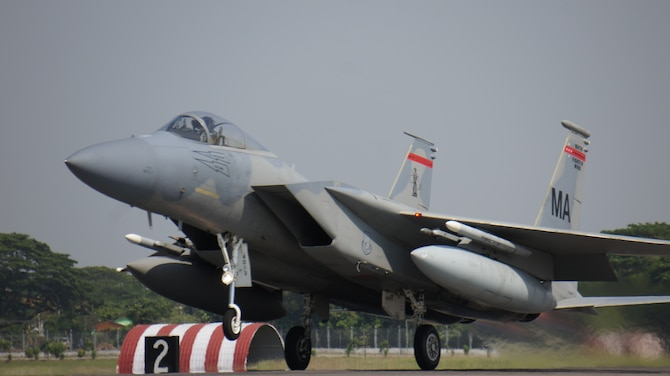 A Massachusetts National Guard F-15 Eagle from the 104th Fighter Wing takes off for the final sortie of Cope Taufan, P. U. Butterworth, Malaysia, June 19, 2014. Cope Taufan is a two week exercise that reinforces U.S. Pacific Command Theater Security Cooperation goals for the Southeast Asian region and demonstrates U.S. capability to project forces strategically in a combined, joint environment. More than 450 Airmen are participating, as well as four U.S. Air Force airframes. (U.S. Air Force Photo By Tech Sgt. Andrew L. Jackson / Unclassified, and Released.)
