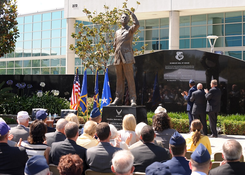 Lt. Gen. Samuel Greaves, SMC commander, and Retired Maj. Gen. Thomas Taverney, AFA General Schriever Chapter chairman, unveil the first names carved on the Space Wall of Honor at a ceremony held here, June 19. (Photo by Joe Juarez)