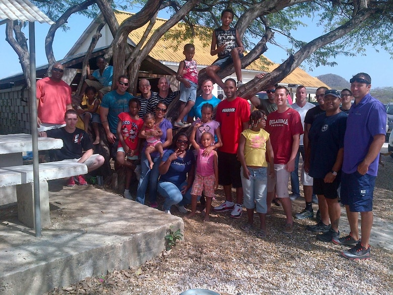 Twenty volunteers from the U.S. Forward Operating Location in Curacao went to the Siloam Village Orphanage and Hospice, June 5, 2014. USFOL volunteers spent two hours caring for the children, demonstrating and reinforcing the USFOL's compassionate image and leaving a lasting, positive imprint on the community. The USFOL also donated funds to support the purchase of clothes, shoes and hygiene items. Personnel from the USFOL often donate time and resources to various programs on the island in appreciation for the hospitality extended to them by the citizens of Curacao.