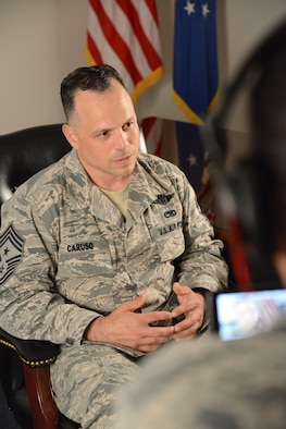 "Chief Master Sgt. Matthew Caruso, the eighth Air Force Special Operations Command command chief, responds to questions May 12, 2014, in his first interview as the ""senior sergeant"" for the command. He returned to Hurlburt Field for his new job after recent posts at Cannon Air Force Base, N.M., and Bagram Air Base Afghanistan, and a tour in the Republic of Korea. (Air Force photo by Master Sgt. Steven Pearsall)"