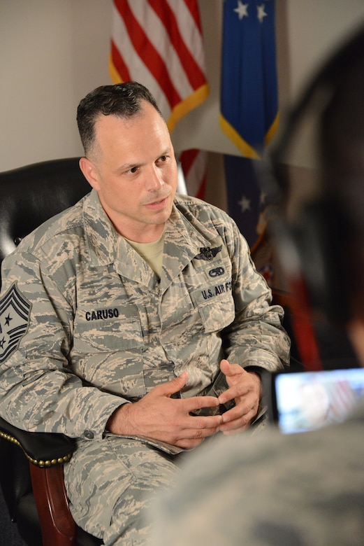 """Chief Master Sgt. Matthew Caruso, the eighth Air Force Special Operations Command command chief, responds to questions May 12, 2014, in his first interview as the """"senior sergeant"""" for the command. He returned to Hurlburt Field for his new job after recent posts at Cannon Air Force Base, N.M., and Bagram Air Base Afghanistan, and a tour in the Republic of Korea. (Air Force photo by Master Sgt. Steven Pearsall)"""