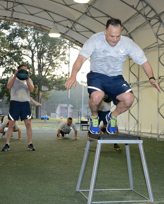 Chief Master Sgt. Matthew Caruso, command chief for Air Force Special Operations Command, works out with several enlisted leaders May 13, 2014, at Hurlburt Field's Aderholt Fitness Center track.  The chief is passionate about physical fitness and focused on improving fitness test scores command-wide.  (Air Force photo by Master Sgt. Steven Pearsall)