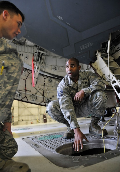 U.S. Air Force Tech Sgt. Broderick Jones, 509th Aircraft Maintenance Squadron aircraft electrical and environmental systems craftsman, explains each dock's ability to provide cooling air to Airman 1st Class Evan Miesner, 509th AMXS electrical environmental apprentice, at Whiteman Air Force Base, Mo., June 10, 2014. Each dock is capable of providing cooling air to the aircraft for operational checks and maintenance. (U.S. Air Force photo by Airman 1st Class Keenan Berry/Release)