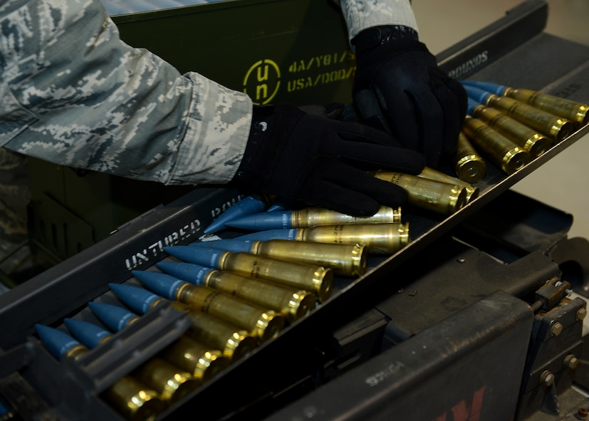 U.S. Air Force Staff Sgt. Jonathan Shelton, 52nd Equipment Maintenance Squadron munitions storage crew chief from Bassett, Va., places 20 mm target practice rounds on a replenisher table at Lask Air Base, Poland, June 12, 2014. An F-16 Fighting Falcon fighter aircraft carries approximately 512 rounds, which were used in multinational exercises BALTOPS 14 and EAGLE TALON to train NATO pilots for future close-air-support missions. Exercises such as these aim to increase interoperability and partnership capacity with NATO nations. (U.S. Air Force photo by Airman 1st Class Kyle Gese/Released)