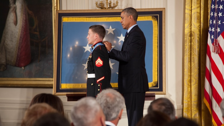 "Cpl. William ""Kyle"" Carpenter receives the Medal of Honor, the nation's highest military honor, from President Barack Obama at the White House June 19, 2014. Carpenter received the medal for his actions while deployed to Marjah, Helmand Province, Afghanistan, in 2010. He became the third Marine and the 15th overall recipient of the medal for actions in Iraq or Afghanistan."