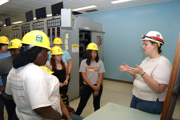 Sarah Cary, a mechanical engineer currently on a developmental assignment to the powerhouse at Keystone Dam, gives a tour of the control room to students in the Tulsa Alliance for Engineering summer camp. Cary and explained the process by which hydroelectric dams create clean electricity.
