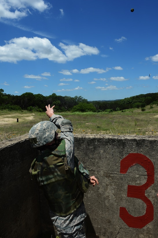 2nd Lt. Paul Harloff, 343rd Training Squadron Basic Officer Course trainee, throws an M67 fragmentation hand grenade while participating in the BOC May 28, 2014, on Joint Base San Antonio-Camp Bullis. The course instructs new security forces officers on the use and proper throwing technique of grenades as part of their familiarization training with equipment their troops will use. (U.S. Air Force photo/Airman 1st Class Krystal Ardrey)