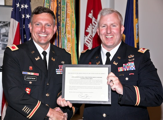 In the presence of family, friends and coworkers, Lt. Col. Christopher Riemer, U. S. Army Corps of Engineers Pittsburgh District deputy commander, bids farewell to his 20-plus year military career at a retirement luncheon, June 13.  During the luncheon, held at the Engineers' Society of Western Pennsylvania in Pittsburgh, Pa., Riemer received his retirement certificate and numerous awards from Col. Bernard Lindstrom and other district leadership.