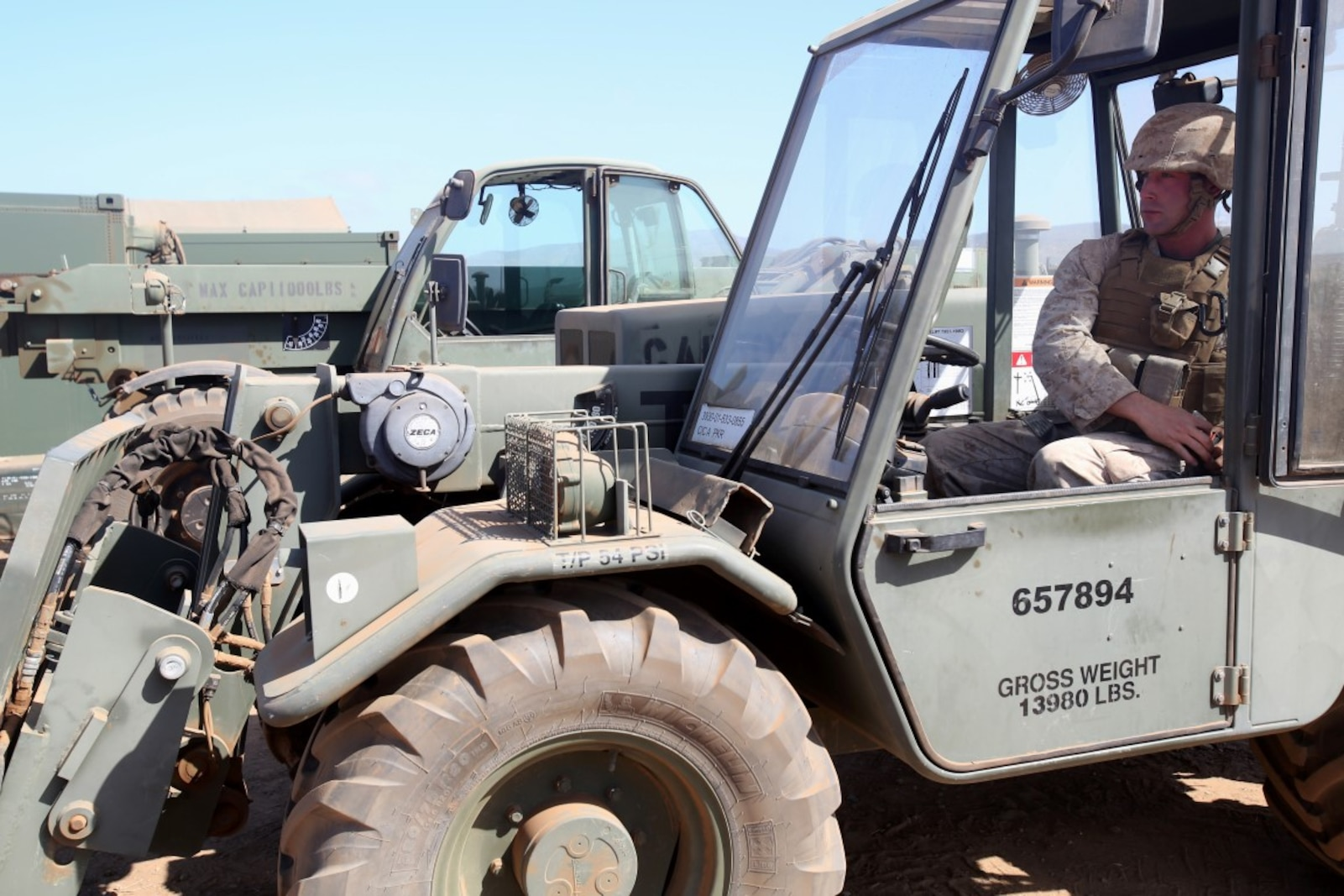 Lance Cpl. Francis Trezza, a heavy equipment operator with 9th Communication Battalion, I Marine Expeditionary Force, prepares to operate a forklift during the 2014 I Marine Expeditionary Brigade command post exercise aboard Camp Pendleton, Calif., June 19, 2014. The CPX was designed to help improve the 1st Marine Expeditionary Brigade's readiness for deployment. (U.S. Marine Corps photo by Lance Cpl. David Silvano/released)