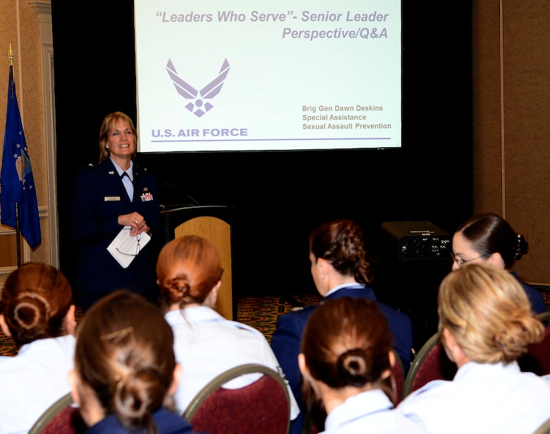 Brig. Gen. Dawne Deskinsencourages Airmen during the 27th Annual Joint Women's Leadership Symposium June 13, 2014, in Norfolk, Va. The second day of the symposium was service specific and the Air Force sessions highlighted the perspective of the service's senior leaders. Deskins is the  Air National Guard sexual assault prevention program officer.  (U.S. Air Force photo/Staff Sgt. Antoinette Gibson)