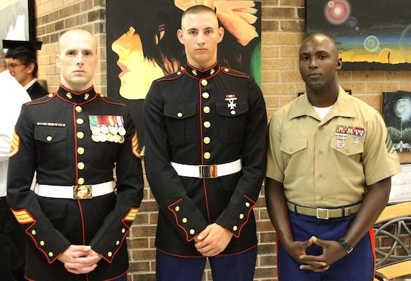 Marine walks with his high school graduation class after finishing school early marine corps - Becoming a marine officer ...