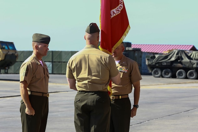 Lieutenant Col. Gilbert D. Juarez (right), past commanding officer for 1st Light Armored Reconnaissance Battalion, 1st Marine Division, I Marine Expeditionary Force, passes the organizational colors to Lt. Col. Christian M. Rankin (left), present commanding officer for 1st LAR, 1st Marine Division, I MEF during a change of command ceremony aboard Camp Pendleton, Calif., June 19, 2014. Juarez served as the commanding officer for two years. (U.S. Marine Corps photo by Lance Cpl. Anna Albrecht)