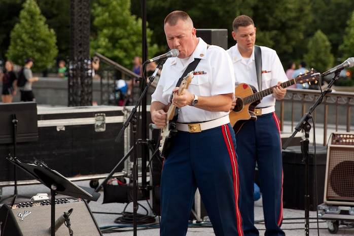 Gunnery Sergeants Alan Prather and Brian Turnmire perform with Free Country, the Marine Band's contemporary country music ensemble, on the west steps of the U.S. Capitol. (U.S. Marine Corps photo by Staff Sgt. Brian Rust/released)