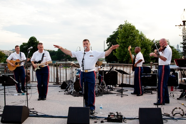Free Country, the Marine Band's contemporary country music ensemble, on the west steps of the U.S. Capitol; L to R: Gunnery Sgt. Brian Turnmire, Gunnery Sgt. Alan Prather, Master Sgt. Kevin Bennear, Master Sgt. Aaron Clay, and Master Gunnery Sgt. Peter Wilson. (U.S. Marine Corps photo by Staff Sgt. Brian Rust/released)
