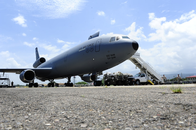 Over 29,000 pounds of humanitarian aid and supplies are unloaded from a U. S. Air Force KC-10 Extender bound for Honduran citizens in need by the 612th Air Base Squadron at Soto Cano Air Base, Honduras, June 6, 2014.  The supplies were sent to Honduras through the Denton Program, which allows private U.S. citizens and organizations to use space available on U.S. military cargo planes to transport humanitarian goods to approved countries in need.  (Photo by Martin Chahin)