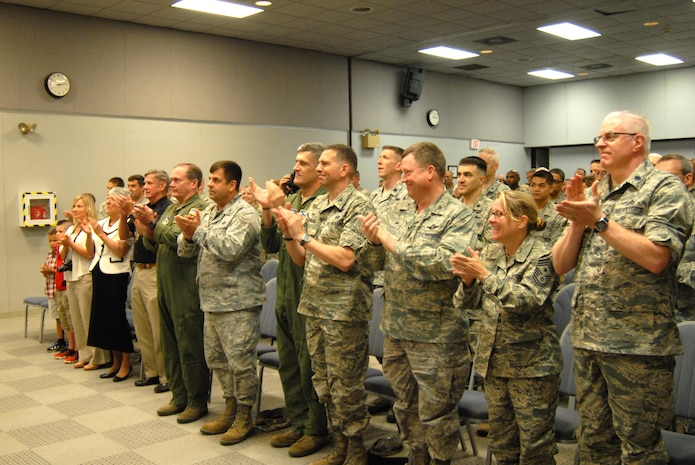 Members of the Delaware Air National Guard and family members of Air Force Maj. Devin Tomaseski, base civil engineer, 166th Civil Engineer Squadron, 166th Airlift Wing, Delaware ANG, applaud after Tomaseski received the Bronze Star medal at a ceremony held at 166th AW HQ, New Castle ANG Base, New Castle, Del. on June 20, 2014. Tomaseski distinguished himself by exceptionally meritorious service while deployed in support of Operation Enduring Freedom in Afghanistan from 2011 to 2012. This is the third Bronze Star medal awarded to Tomaseski. (U.S. Air National Guard photo by Tech. Sgt. Benjamin Matwey)
