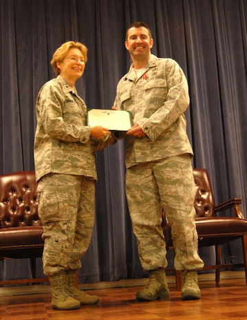 Air Force Brig. Gen. Carol Timmons, assistant adjutant general for air, Delaware National Guard, with Air Force Maj. Devin Tomaseski, base civil engineer, 166th Civil Engineer Squadron, 166th Airlift Wing, Delaware Air National Guard, after Tomaseski received the Bronze Star medal at a ceremony held at 166th AW HQ, New Castle ANG Base, New Castle, Del. on June 20, 2014. Tomaseski distinguished himself by exceptionally meritorious service while deployed in support of Operation Enduring Freedom in Afghanistan from 2011 to 2012. This is the third Bronze Star medal awarded to Tomaseski.  (U.S. Air National Guard photo by Tech. Sgt. Benjamin Matwey)