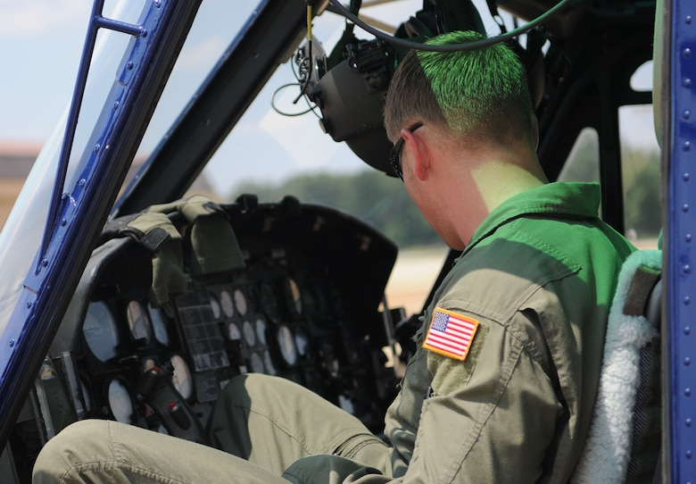 Staff Sgt. Mark Cornett, 1st Helicopter Squadron special missions aviator instructor, checks the instruments on a UH-1N Huey helicopter on Joint Base Andrews, Md., June 17, 2014. (U.S. Air Force photo/Airman 1st Class Ryan J. Sonnier)