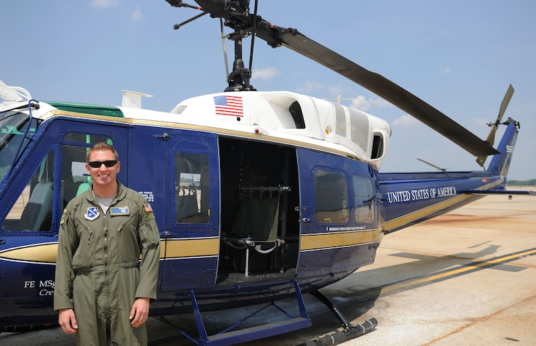Staff Sgt. Mark Cornett, 1st Helicopter Squadron special mission aviator instructor, stands in front of a UH-1N Huey helicopter assigned to the 1st Helicopter Squadron on Joint Base Andrews, Md., June 17, 2014. Cornett was deployed to Afghanistan from December 2012 – December 2013. (U.S. Air Force photo/Airman 1st Class Ryan J. Sonnier)