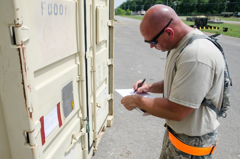 Staff Sgt. Kevin Freese, an aerial porter for the Kentucky Air National Guard's 123rd Contingency Response Group, makes a cargo manifest for transportation to a staging area called the forward node during Capstone '14, a homeland earthquake-response exercise at Fort Campbell, Ky., on June 18, 2014. The 123rd CRG is joining with the U.S. Army's 688th Rapid Port Opening Element to operate a Joint Task Force-Port Opening here from June 16 to 19, 2014. (U.S. Air National Guard photo by Master Sgt. Phil Speck)