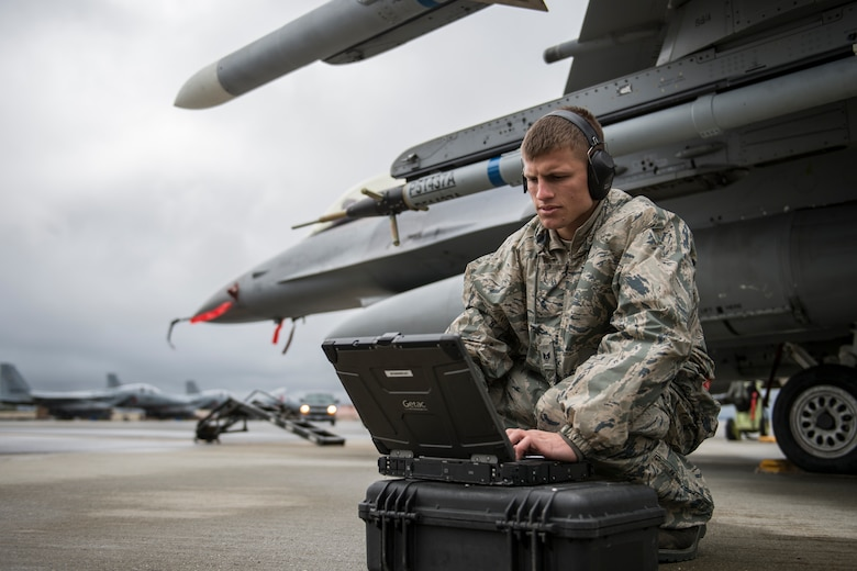 U.S. Air Force Staff Sgt. Zackery Coder, 36th Aircraft Maintenance Unit crew chief assigned to Osan Air Base, South Korea, checks computer data during RED FLAG-Alaska 14-2, June 19, 2014, Eielson Air Force Base, Alaska. Coder ensured the F-16 Fighting Falcon was ready for the next sortie. (U.S. Air Force photo by Senior Airman Peter Reft/Released)