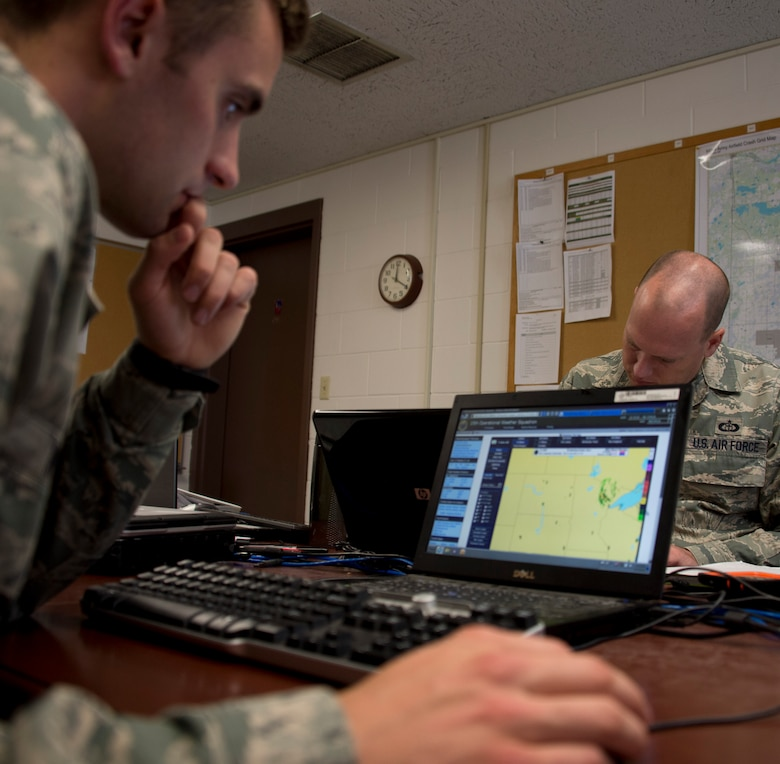 U.S. Air Force Senior Airman Timothy Wigton, 208th Weather Flight, reviews weather conditions over the East Coast while in Little Falls, Minn., June 12, 2014. Wigton is in the last phase of his upgrade skill training during which he was evaluated on his knowledge of weather. 