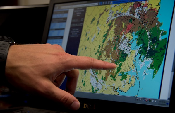 U.S. Air Force Senior Airman Timothy Wigton, 208th Weather Flight, points out East Coast weather conditions while in Little Falls, Minn., June 12, 2014. Wigton is in the last phase of his upgrade skill training during which he was evaluated on his knowledge of weather. 
