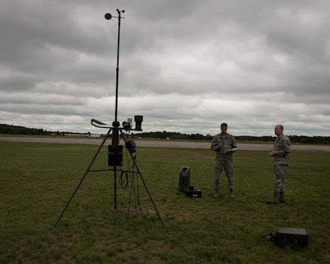 U.S. Air Force Master Sgt. James Emery, right, and Senior Airman Timothy Wigton, both from the 208th Weather Flight, collect weather information in Little Falls, Minn., June 12, 2014. Emery and Wigton participated in a training exercise with the Minnesota Army National Guard, Charlie Company, 834th Aviation Support Battalion where they provide up to date weather conditions for the pilots.   (U.S. Air National Guard photo by Tech. Sgt. Amy M. Lovgren/Released)