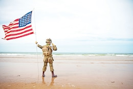A French child, dressed as an American World War II Soldier, stands tall June 6 while saluting the sands of Omaha Beach, France. The boy, never breaking composure, stood for more than two hours during a 1st Inf. Div. ceremony that helped commemorate the 70th anniversary of the D-Day landings.