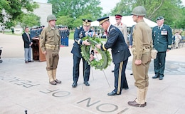Lt. Gen. Mark A. Milley, commanding general, III Corps and Fort Hood, Texas, and Maj. Gen. Paul E. Funk II, 1st Inf. Div. and Fort Riley commanding general, lay a wreath in honor of the 70th anniversary of D-Day June 6 at the Eisenhower Center in Abilene, Kan.