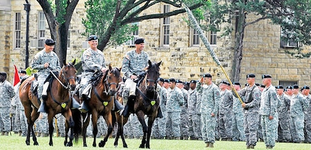 Col. Miles Brown, incoming 2nd ABCT commander; Maj. Gen. Paul E. Funk II, commanding general, 1st Inf. Div. and Fort Riley; and Col. Jeffery Broadwater, outgoing 2nd ABCT commander, conduct an inspection of troops on horseback June 5 at Cavalry Parade Field. Brown took command of the 2nd ABCT from Broadwater during a change of command ceremony.
