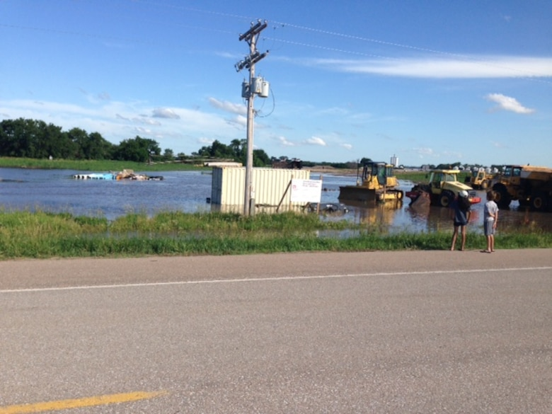 Lowland flooding caused by severe storms during the weekend of June 20, 2014 inundated the Shell Creek levee construction staging area in Schuyler, Neb.