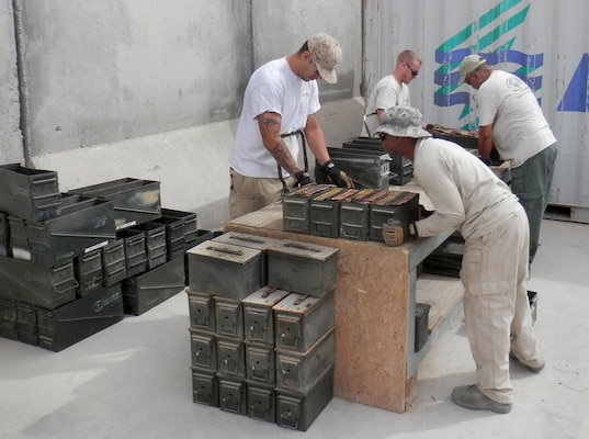 Personnel supporting joint munitions disposal operations in Afghanistan are delinking .50 caliber rounds, or taking them out of their links, and placing them loosely in cans for later burning in the incinerator, the approved method for disposal.