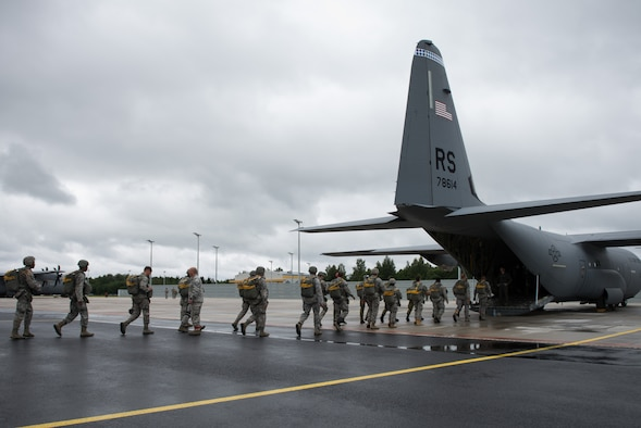 Airmen from the 435 Contingency Response Group and Estonian service members board a C-130J Hercules for parachute training during the Air Force-specific portion of Saber Strike June 18, 2014, on Lielvarde Air Base, Latvia. During the final week of Saber Strike 2014 the 435th CRG, in conjunction with the 37th Airlift Squadron, trained on the full capabilities to open the Latvian air base. They also trained with Latvian and Estonian service members on airfield operations, command and control of air and space forces, weather support, and protection of operational forces, aircraft maintenance, and aerial port services. (U.S. Air Force photo/Senior Airman Jonathan Stefanko)
