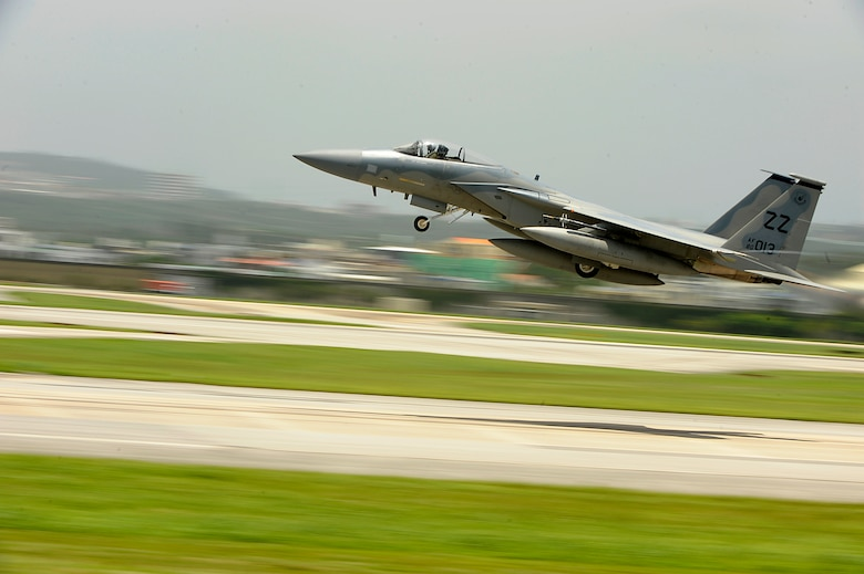 A 44th Fighter Squadron F-15C Eagle takes off from Kadena Air Base, Japan, June 18, 2014, for aviation training relocation to Andersen Air Force Base, Guam. The ATR provides service members from Kadena AB the opportunity to integrate with Pacific Air Forces units in the region and strengthen the Air Force's ability to respond to a potential threat in the region. The repositioning also relieves the noise impact of Kadena AB jets on the local community. (U.S. Air Force photo/Senior Airman Maeson L. Elleman)