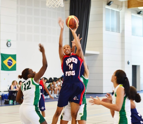 Army SPC Danielle Salley drives the rim over Brazil.  The U.S. Armed Forces Women's Basketball team competed in the 2014 Conseil International du Sport Militaire (CISM) Basketball Championship in Meyenheim, France from 15-22 June.